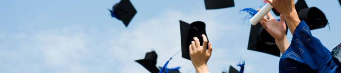 Graduation image, caps being thrown in the air